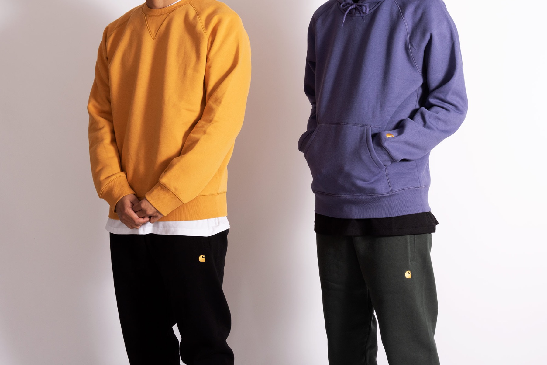 carhartt wip chase tracksuits in dark teal, cold viola, winter sun & black